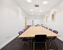 Thumbnail of a Rapid Formations conference room based on Shelton Street in Covent Garden, London. The room is bright and spacious, features abstract art, purple chairs and a wide conference table.