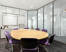 Thumbnail of a Rapid Formations conference room based on Shelton Street in Covent Garden, London. The room is bright and spacious, features a white board, purple chairs and a circular conference table.