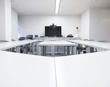 Thumbnail of a Rapid Formations conference room based on Bath Street in Glasgow city centre. The room features a large TV for video conferences, a square table and plenty of comfortable meeting chairs.