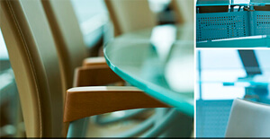 Four images of a boardroom that features empty tan chairs and a clear glass table have been mashed together in one frame.